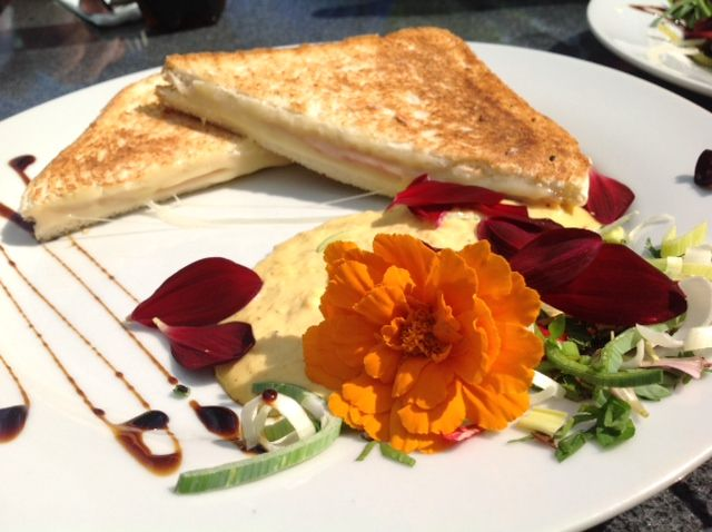 An edible flower can lift a plate of a simple sandwich by so much!