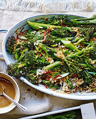 Tenderstem broccoli is roasted with chilli, garlic and spring onions and paired with an aromatic miso dressing in this vibrant, vegan salad. | Tesco