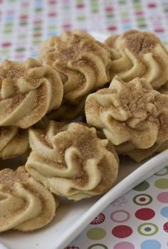 Snickerdoodle Spritz Here's an excuse to buy that cookie press you've been staring at in the baking store. Or if the caulking gun of the food world doesn't do it for you, the dough for these cookies also can be scooped into a plastic bag, then piped out into decorative rounds.