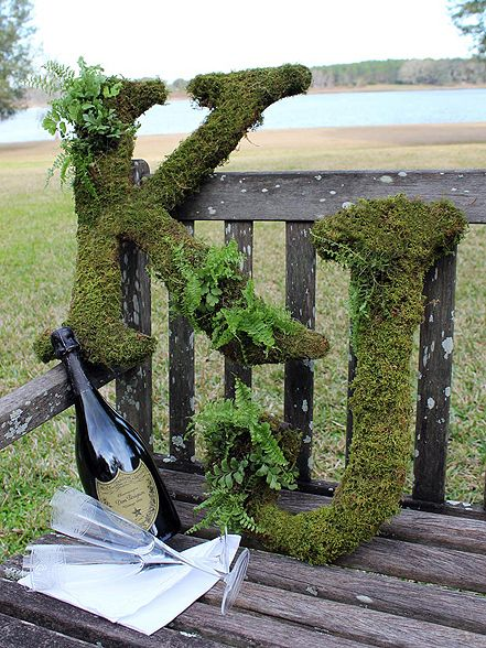 Moss Covered Letters for wedding, like the idea better if they were covered with flowers that matched the bridesmaids bouquets.