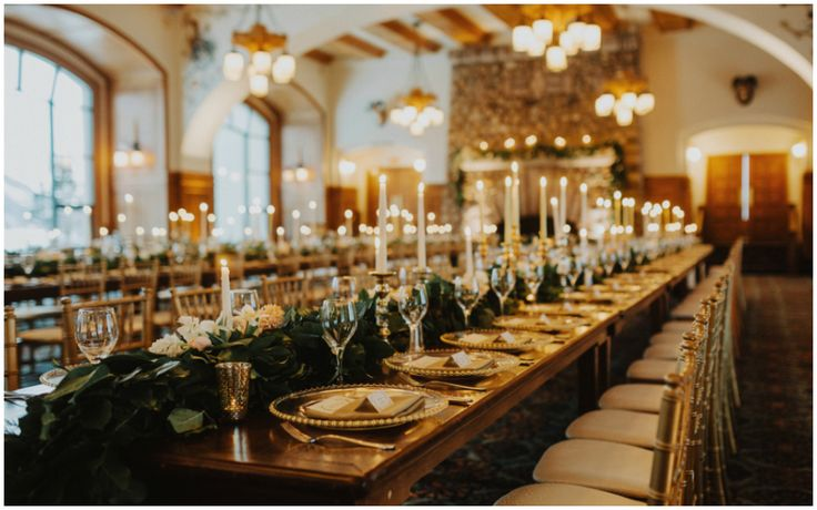 Long Harvest Wooden Tables with Lush Greenery and Floral Garland. Winter Destination Wedding at The Fairmont Chateau Lake Louise
