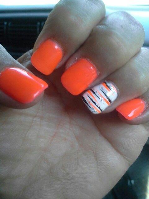 Orange & white w/black, orange & silver sparkle.  4 Seasons by Kelly.