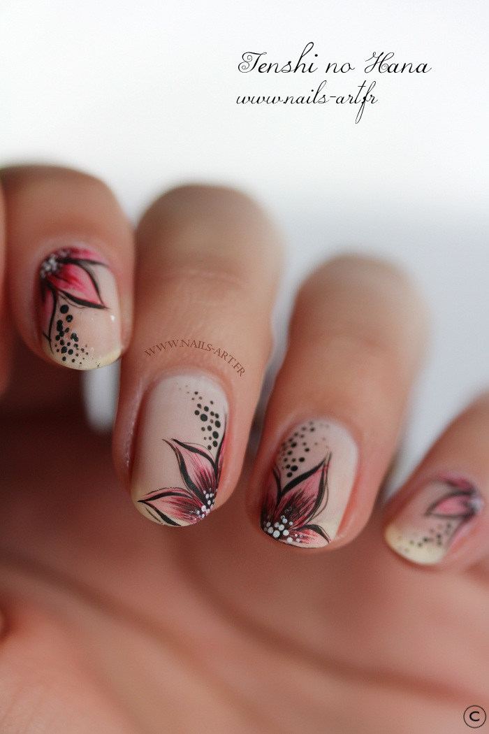floral motif in pinks and black over nude pink manicure