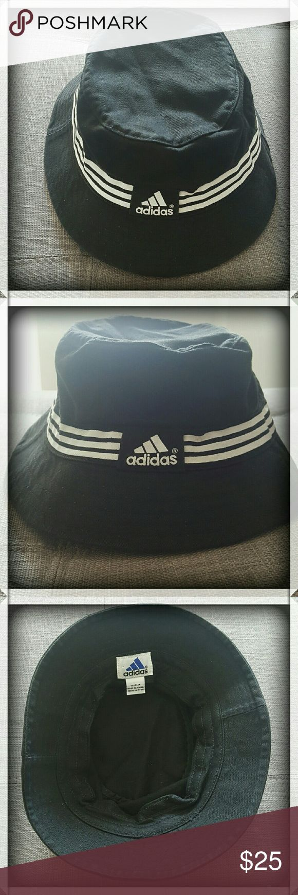 """Adidas Bucket Hat Rare black and white vintage Adidas bucket hat. Looks so cool on boys and girls. Takes you back to times of Run DMC and the Golden Age of Hip Hop. Really special hat that also protects your child from the sun. My son loved wearing this hat, but he grew out of it, unfortunately. Size says """"Toddler"""", I'd say up to two-year-old or less. Bundle with other items for discount. Please ask any questions before purchase. Adidas Accessories Hats"""
