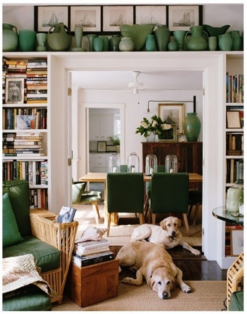 I love the wide door opening framed with bookshelves, especially the display area overhead. Although a bit too cluttered for my taste.