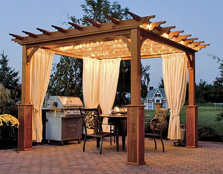 wood gazebo on patio with outdoor kitchen