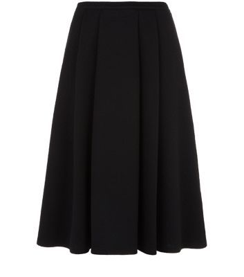 """Invest in a versatile black midi dress for the autumn season - wear with lace cami and black ankle strap heels for an evening out.- Pleated design- Stretch jersey fabric- Flared design- Midi length- Casual fit- Model is 5'8""""/176cm and wears UK 10/EU 38/US 6"""