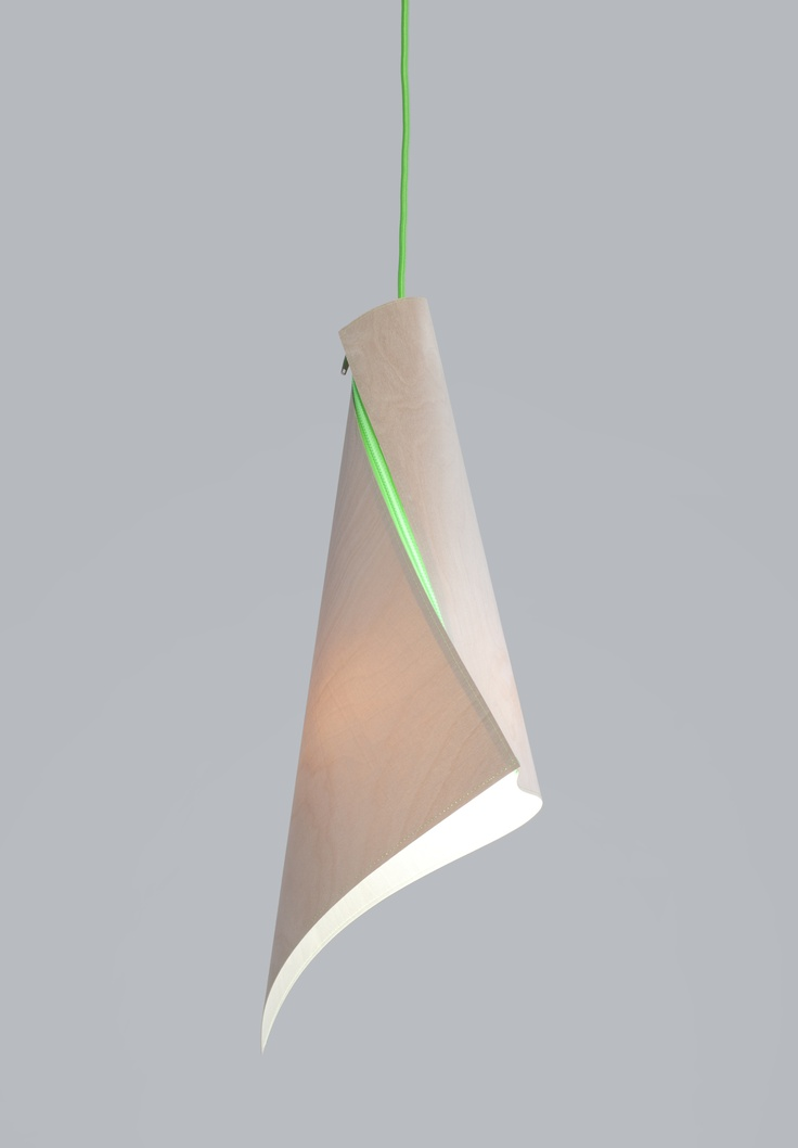 Arkki light. When zipped, the plywood light shade takes on its three dimensional shape.