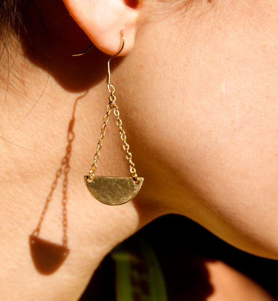 Brass semi circle crescent shape dangle earrings with 14k gold plated chain earrings $40.00 USD Handmade item Materials: brass, gold Made to order Feedback: 5 reviews Ships worldwide from California, United States I HAVE A LARGE SELECTION TO CHOOSE FROM!