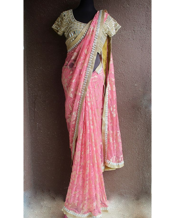 Blush pink chantilly net sari with mirror and pearl work border and copper accent