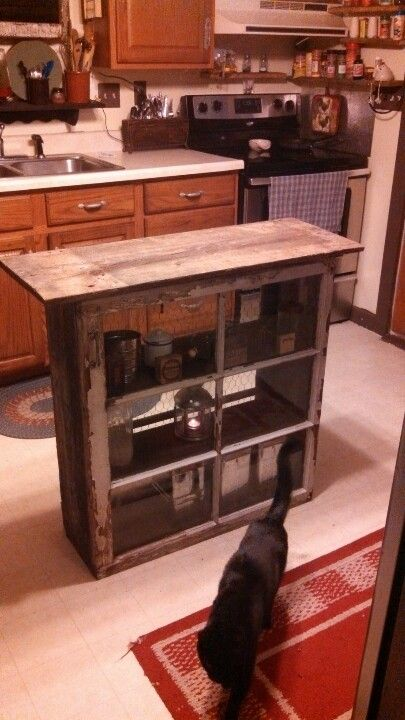 Made with old windows and barn wood as a kitchen island