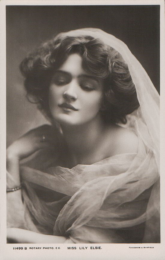 Miss Lily Elsie (1886 - 1962).  On the stage Elsie seemed mysteriously beautiful with her perfect Grecian profile, enormous blue eyes, and hauntingly sad smile.  Tall, cool, and lily-like, she moved with lyrical gestures in a slow-motion grace.