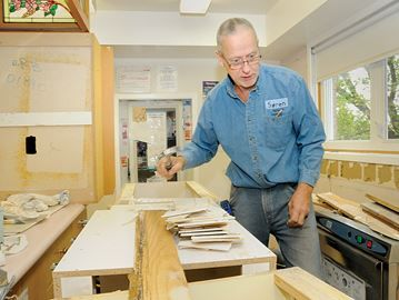Barrie Women and Children's Shelter gets kitchen reno - Soren Madsen, from Yafe, was busy replacing the old cabinets.