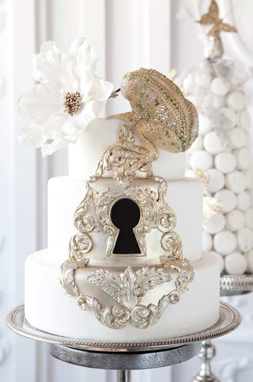 This wedding cake from The Cake Opera Co. features a golden frog!