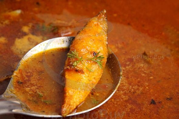 Preparation of Pomfret fry fish curry
