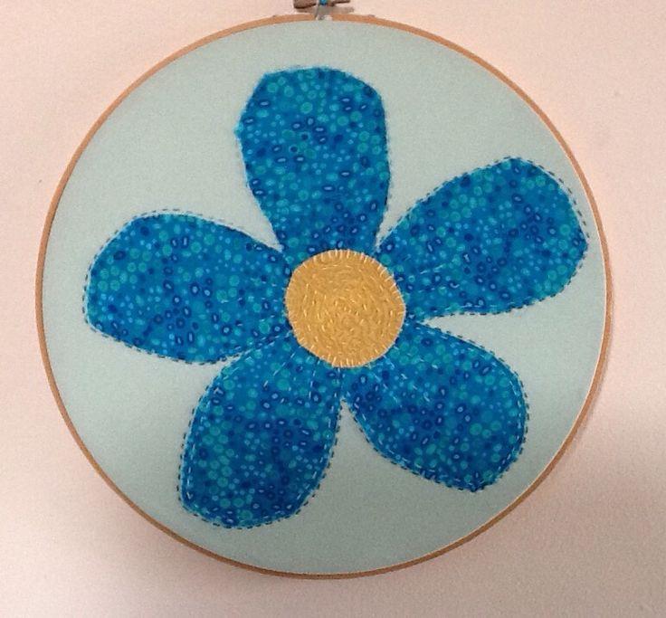 Embroidered flower in hoop