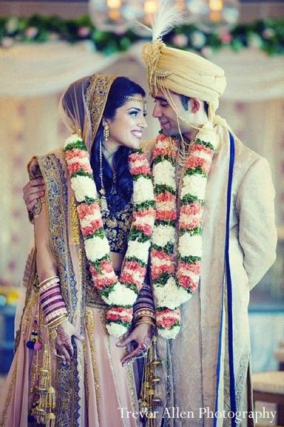 For their beautiful ceremony, this bride and groom tie the knot under a beautiful floral mandap!