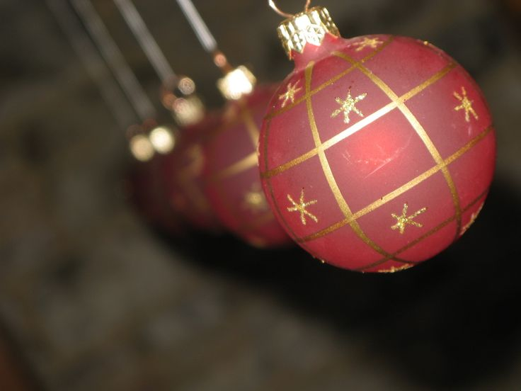 Hanging some Christmas baubles from the ceiling adds a nice touch over the dining table