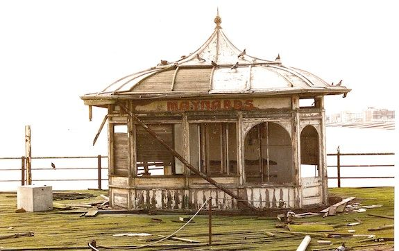 Brighton West Pier Maynards kiosk in a state of ruin. The Pier closed in 1975 .