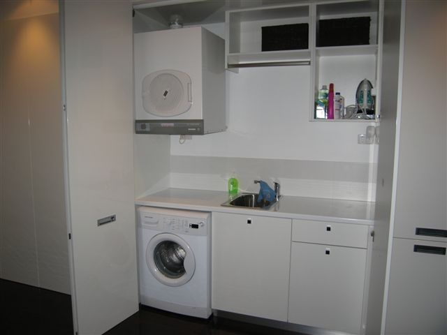 Small laundry behind doors - want more bench and hanging rack