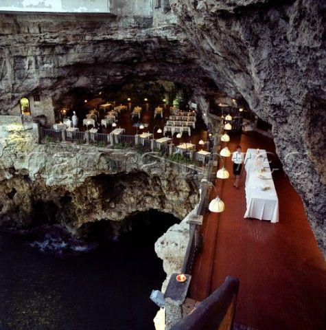 Grotta Palazzese restaurant on water's edge Polignano a Mare (Bari) Puglia in Italy