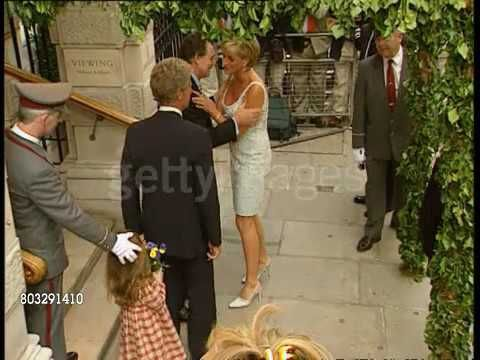 June 02, 1997: Princess Diana Princess of Wales dress pre-auction private viewings at Christie's in London, England. Diana, Princess of Wales (wearing knee-length white sequinned dress) gets out of car and is welcomed. This is a private viewing of her dresses before they went to auction in New York. (ITN Video clips).