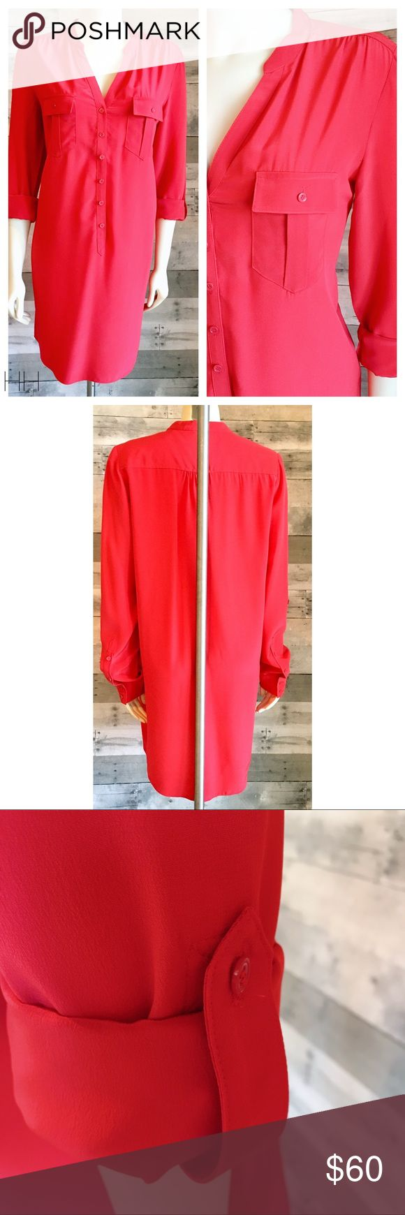 100% silk shirt dress roll sleeves orange red Classic shirt dress with front pockets and button down placket.  Dress features roll sleeves to serve as either full length sleeve or 3/4 sleeve.  100% silk No belt included Haute Hippie Dresses
