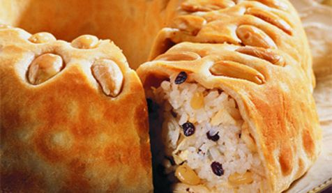 pilaf with chicken and nuts enveloped in thin dough topped with almonds ( Turkish Perde Pilavı)