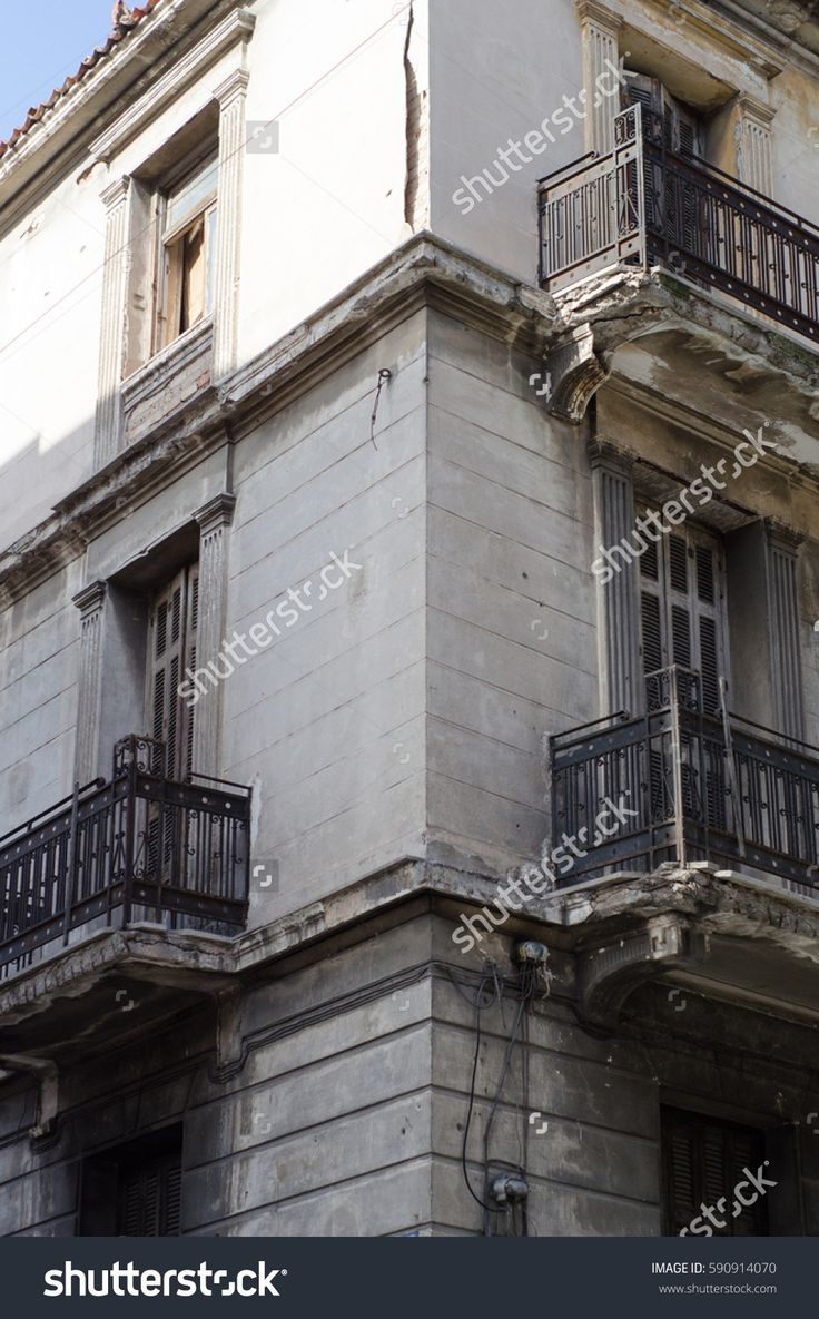 New classic house in athens first floor with crafted iron handrails, marble balconies, wooden windows angle view, habitable in very good condition preserved,angle view