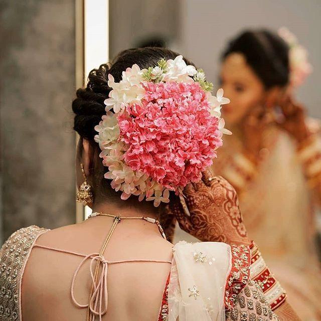 Pink And White Floral Bun Bridal Hair Buns Bridal Bun Indian Wedding Hairstyles