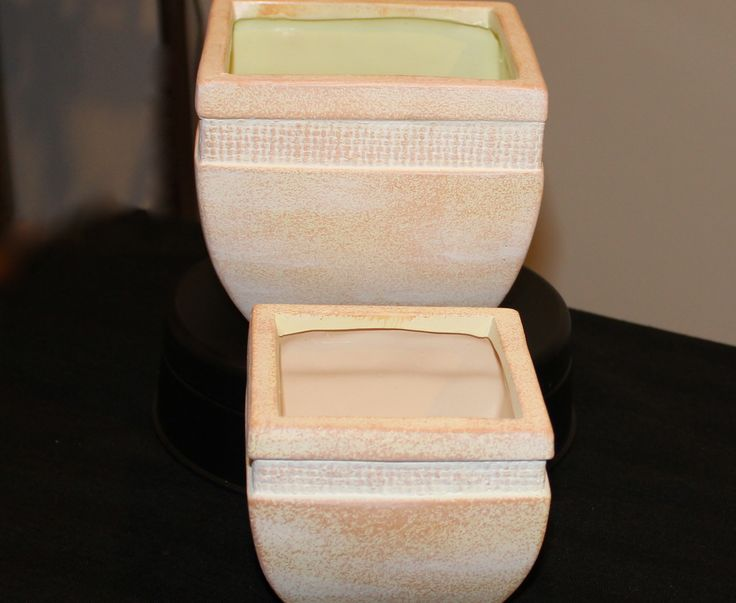 """Set of 2 .Planters -The smaller one is 4"""" square x 4"""" high...the larger one is 5"""" square and 5"""" tall...Beige in color w/ textured detail near rim...Order # W1506-2...$14.95"""