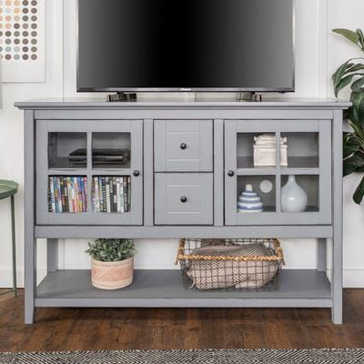 The added height and style of this console table make it a perfect fit for any room in your house, whether it be for entertaining, dining, or decorative purposes. Crafted from high-grade MDF, this stand accommodates most TVs up to 55 inches. Features adjustable shelves behind glass-paned doors to provide ample storage space for media components or decorative accessories. Includes two multi-functional storage drawers and a spacious bottom shelf.