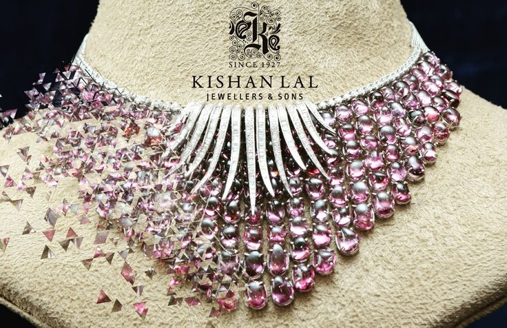 Embrace your neck with this beautiful spinnle and diamond necklace.
