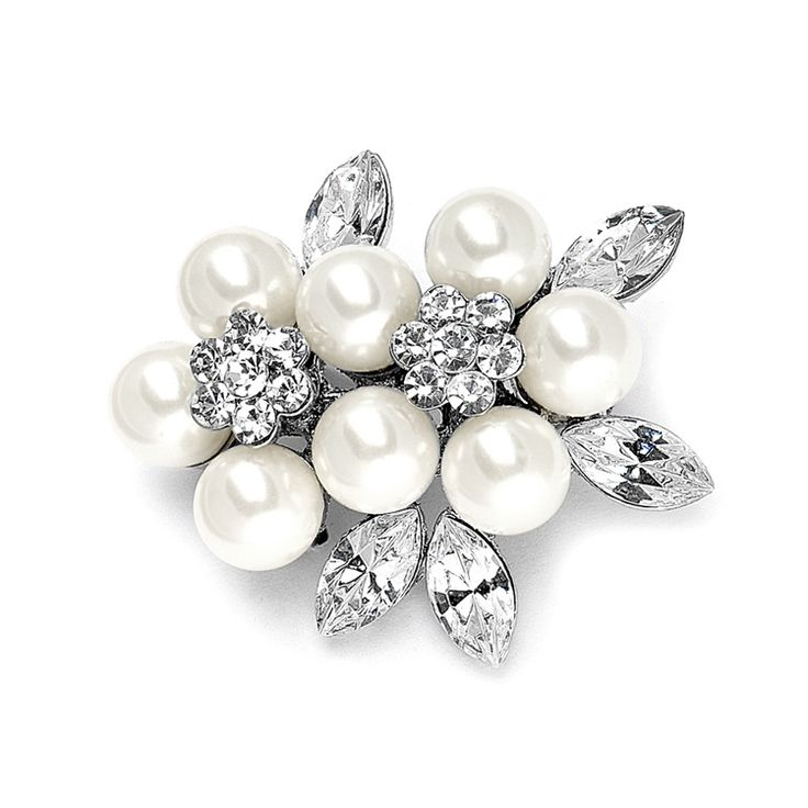 This elegant bridal brooch features a cluster of soft cream 8mm pearls mixed with marquis crystals. Aluxurious pin that is 1 1/2 h x 1 3/8 w and is the ideal accent to wedding gowns or wraps. Convert to a beautiful bridal hair comb with our comb adaptor.Just slide the pin through the comb's