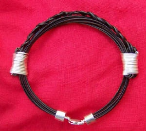 Bracelet braided hair between knots -silver wire. Fits any size. Price $210 incl. ship & insurance