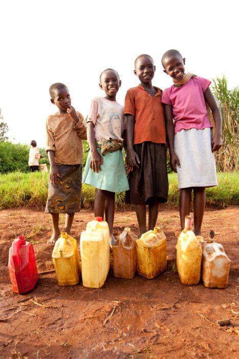 Africa   Girls in rural Rwanda smile after collecting water for their families. (photo: Esther Havens)