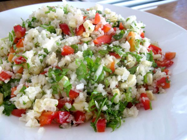 Jicama Mexican Rice  makes 4 servings    4 cups jicama, peel, dice  1/2 cup onion, yellow, chop  1 cup corn kernels  1 cup red bell pepper, dice  1/2 cup cilantro, chop  1/2 jalapeno pepper, chop, to taste (about 1 tablespoon)  1/8 teaspoon sea salt  2 tablespoons olive or hemp oil, optional  Place jicama in food processor, process into small bits. Be careful not to over process. Scoop into mixing bowl. Add remaining ingredients, toss to mix well.