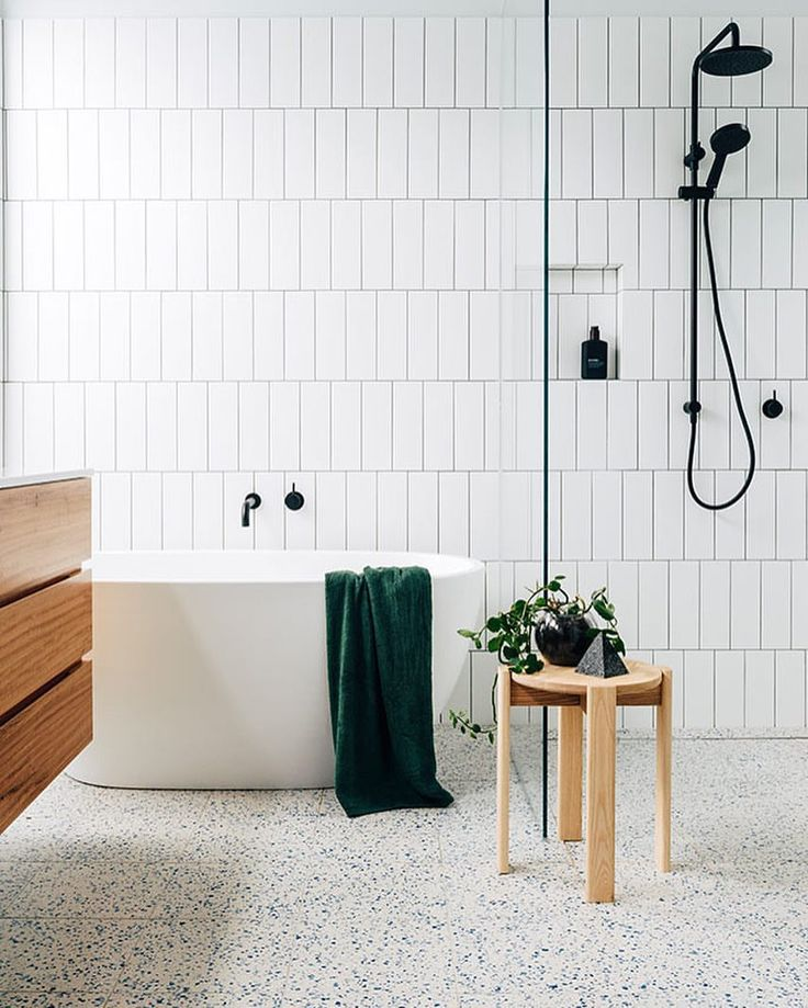 """346 Likes, 4 Comments - @stylesourcebook on Instagram: """"Simple and timeless design! Love the vertical tiles and flooring in this bathroom by @bybrunostudio…"""""""