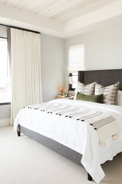 Love the calm vibe of this bedroom, maybe Benjamin Moore Moonshine?