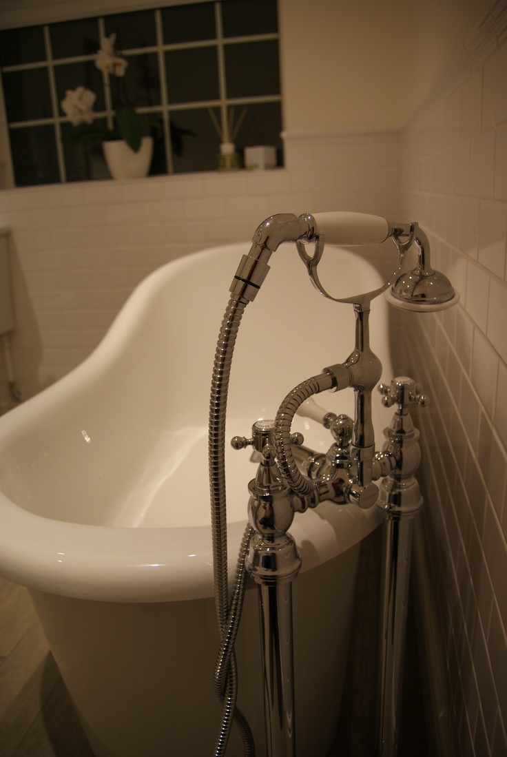 Contemporary slipper bath with heritage taps