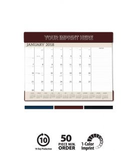 Product: 1D510 Vinyl Desk Pad 2018 Calendar Personalize with your imprint! This desk pad has a pocket-header made of heavy Suedene vinyl. The advertiser's message is hot-stamped on the top giving repeated ad exposure. A clear vinyl pocket-footer provides a useful place to tuck cards or notes. December top sheet is included at no charge; grid includes Julian dates. Choose from a gold or silver imprint on our black, burgundy or navy stocks. Norwood Publishing / 6550