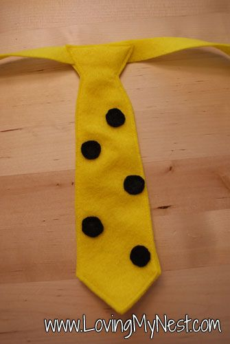The man with the yellow hat costume tie
