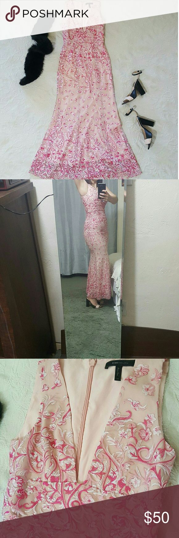 Pink BCBG gown Very beautiful mesh and embroidery gown. Pale and bright pink contrasting floral pattern! Perfect for a wedding or formal event. Size 2 but with PLENTY of stretch! I'm a size 4 and was able to zip it. I couldn't breathe, but it zipped. ;) 56L 14B 17H laid flat. BCBG Dresses
