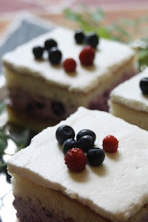 Blueberry cake with real forest blueberries - and some wild strawberries for decoration.