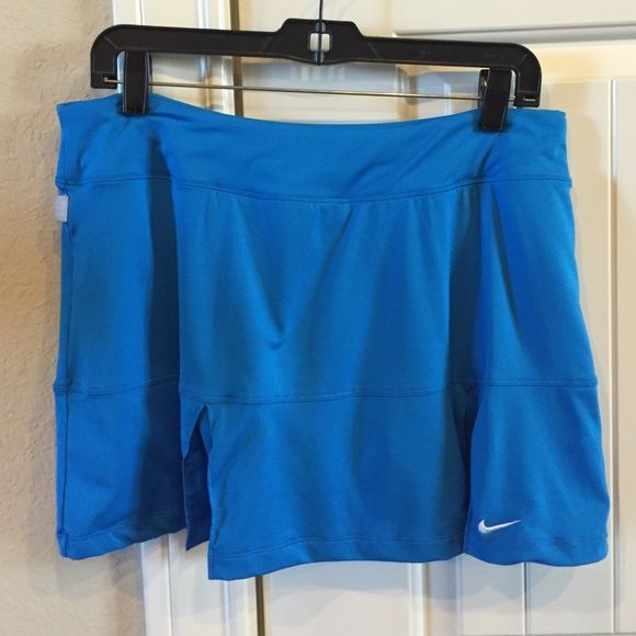 Nike Tennis Skirt Nike tennis skirt with built in tights; skirt 14 inches back length; great condition Nike Skirts