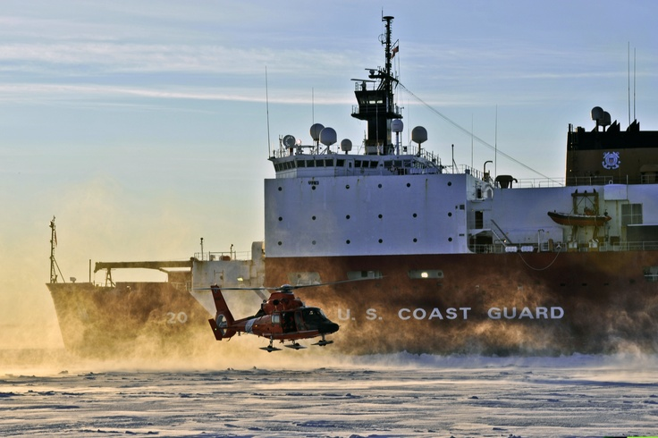 A U.S. Coast Guard MH-65 Dolphin helicopter lands on an ice sheet near Nome, Alaska, Jan. 18, 2012. The helicopter and crew traveled with the USCGC Healy as it escorted the Russian tanker Renda across the Bering Sea to deliver fuel to Nome, Alaska. U.S. Coast Guard photo by Petty Officer 2nd Class Eric J. Chandler.