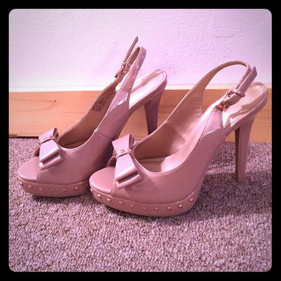 Bow & Studded Pumps Classy bow and studded sling back pumps! NEW BEEN WORN! A few marks here and there from moving a few times but it brand new shape. All studs still intact. Blush/tan tone LC Lauren Conrad Shoes Heels