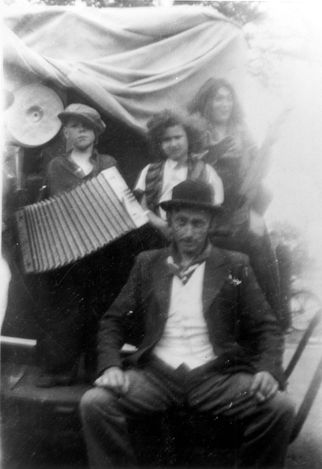 Overijssel, Netherlands, Marion Kaufmann with a Gypsy family that hid her for a month.