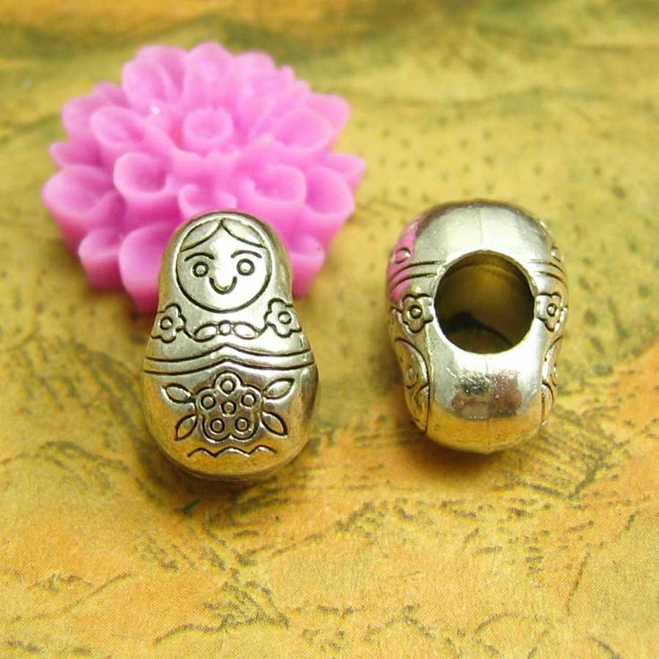 20 pcs Silver Matryoshka Dolls Beads Russian Doll Beads Metal Beads 13x8mm Double Sided CH1686 by kinacraft on Etsy https://www.etsy.com/listing/200698638/20-pcs-silver-matryoshka-dolls-beads