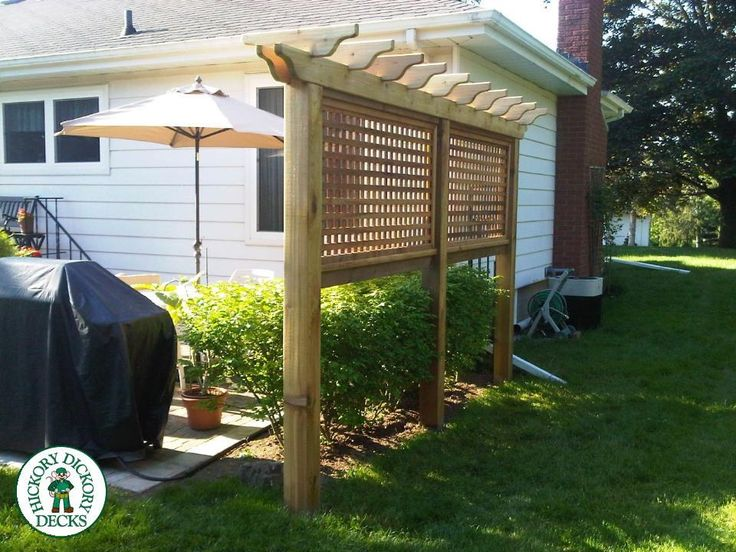 A privacy/ Trellis combo behind their decorative bushes provides them with the shade from the brite sun in the evening and gives the backyard the character